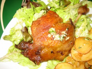 Duck leg confit. Cooked in its own fat for hours. I skipped the 'taters.